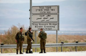 Israeli soldiers stand guard near the entrance to Allenby Bridge, a crossing point between Jordan and the occupied West Bank, near Jericho